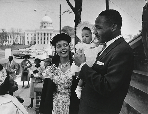 Martin Luther King Jr. with Coretta Scott King and their daughter Yolanda on the steps of the Dexter Avenue Baptist Church  Dan Weiner (1919–1959)  Gelatin silver print, 1956
